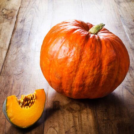 Autumn pumpkin on wooden table.  photo