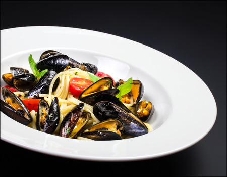 Gourmet mussels with fresh italian pasta photo