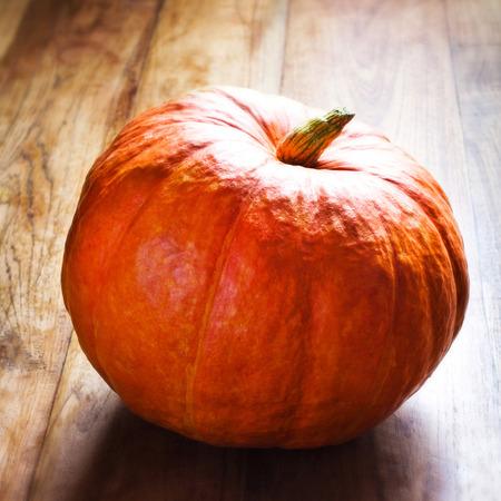 Autumn pumpkin on wooden table. Beautiful autumn Pumpkin thanksgiving background photo