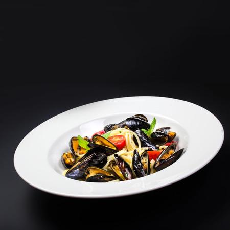 Italian pasta with Mussels marinara photo