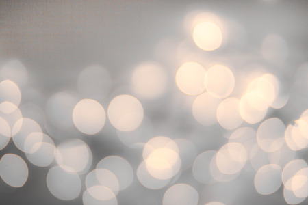 grey skies: Vintage Christmas background with bokeh lights. Stock Photo