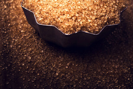 brown sugar: Christmas golden  Food background with copy space. Shiny Brown sugar on wooden background close up, still life.