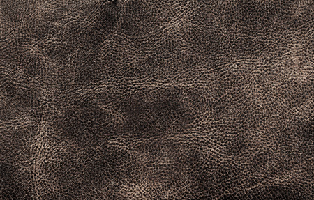 Brown leather texture background surface closeup for your design, ad, wallpaper, poster,  cover. photo