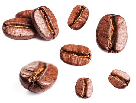 Collection of Roasted Coffee Beans isolated on white background. Closeup, macro. Banco de Imagens
