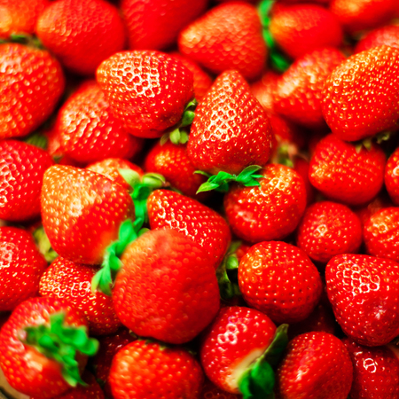 rich flavor: Strawberry  background on a market stall close-up. Food healthy backdrop full frame