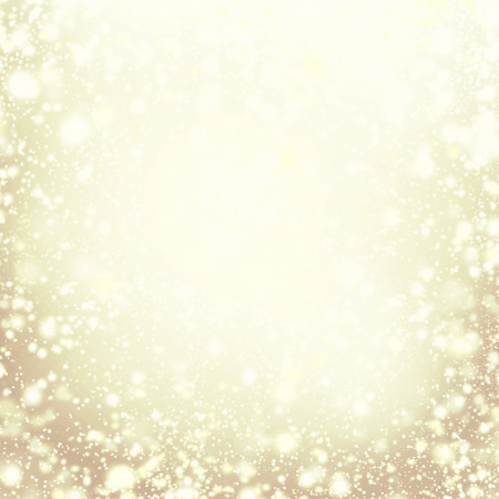 background card: Christmas background - gold sparkling lights. Defocused golden Background Stock Photo