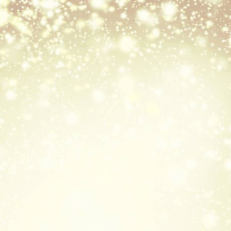 Gold sparkles - Christmas Defocused Lights Background with winter snow flakes Banco de Imagens