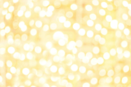 Abstract Sparkling Golden lights with bokeh effect. Yellow boke circles with defocused background. Splashes of champagne Banco de Imagens