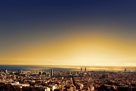 center city: Barcelona - a bird view over city. Catalonia, Spain. Night, sunset