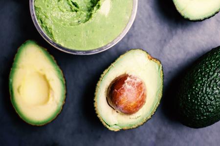 Halved avocados. Top view. Avocado spread. Avocado pasta. Guacamole