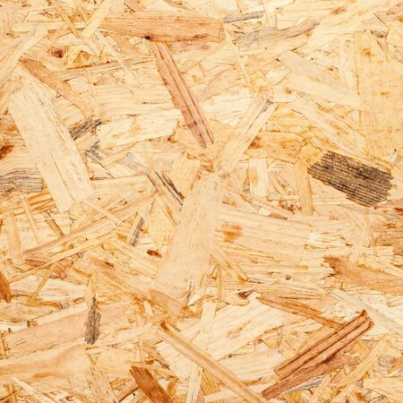 osb: Pressed wooden panel background, seamless texture of oriented strand board - OSB
