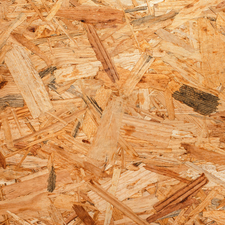 oriented: Pressed wooden panel background, seamless texture of oriented strand board - OSB