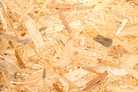 osb: OSB material Texture - Recycled compressed wood chippings board, plywood texture.