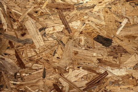 OSB material Texture - Recycled compressed wood chippings board, plywood texture.