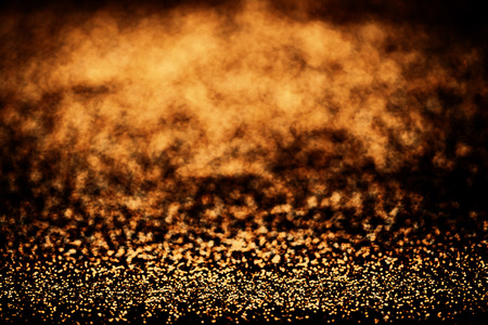 wallpaper copper gold golden: Gold shimmer background with shiny golden and black lights. Sparkle glitter Abstract golden texture background