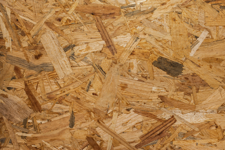 compacted: OSB - Pressed wooden panel background, seamless texture of oriented strand board Stock Photo