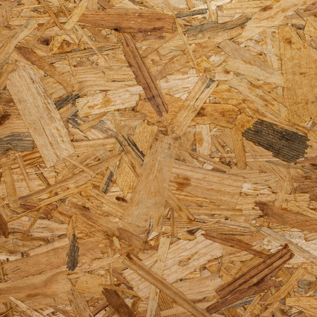 osb: OSB - Pressed wooden panel background Stock Photo