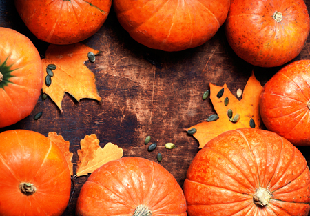 Autumn wood background with pumpkins over wooden table with copyspace. Fall background, wallpaper, poster