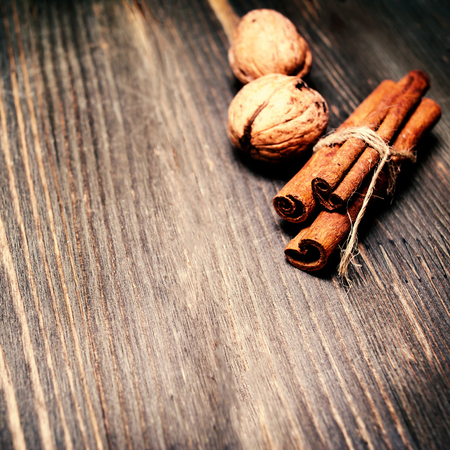 tied together: Cinnamon sticks tied together  with ribbon on wooden table close up with copyspace