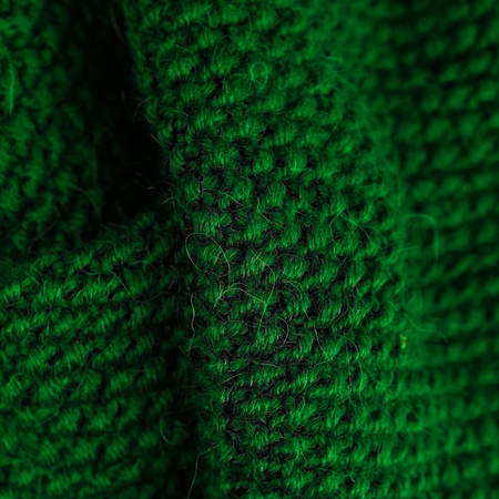 ashy: Green Winter  knitting woolen texture background. Colorful knitted horizontal textured background. Christmas and New Year Wool Design Background