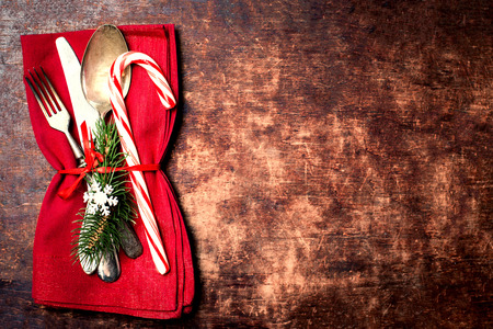 set up: Christmas table place setting with christmas ornaments and copy space for greeting text