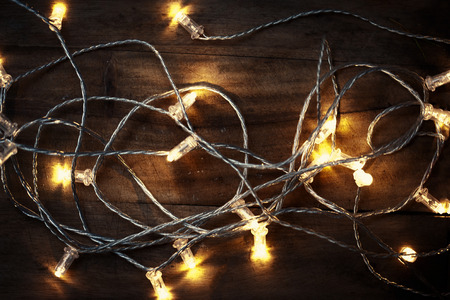 christmas lights garland on a old wooden floor merry christmas lights wallpaper stock photo