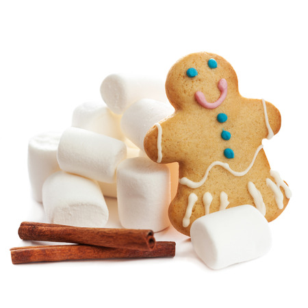 marshmellow: gingerbread man cookie with marshmallows isolated over white background.