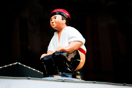 Barcelona, Spain - December 9, 2015: Christmas market items - the Caganer, typical catalan character. This represents someone defecating, Catalonia Christmas traditional symbol