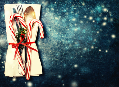 Christmas table place setting with christmas decor on dark background