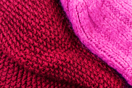 wool texture: Red knitting wool texture background. Colorful knitted horizontal textured background.