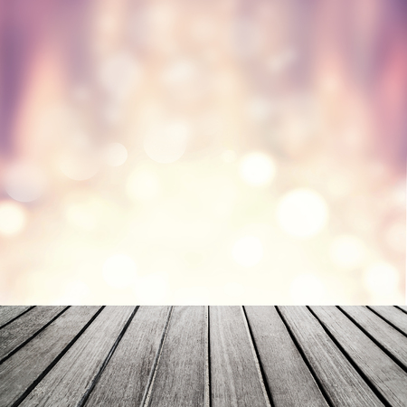 christmas lights display: Empty wooden table for product display with wood board table in front of Christmas glitter lights with festive bokeh