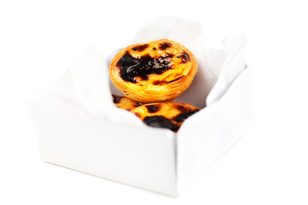 Pastel de Nata - creamy egg tart with  sweet curstard in a box isolated on white