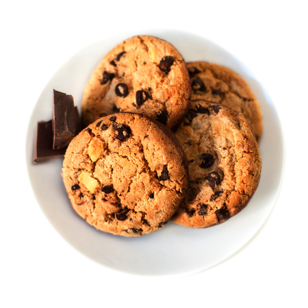 Chocolate chip cookies macro  isolated on white background. Closeup of a group of assorted cookies with chocolate chunks.  Stock Photo