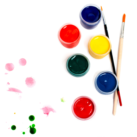 Paints and brushes isolated on white background. Colourful Paint cans Stock Photo