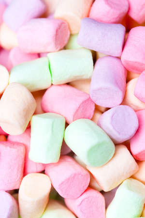 Colorful marshmallows as  background, macro. Fluffy marshmallows texture  or  pattern, close up. Stock Photo