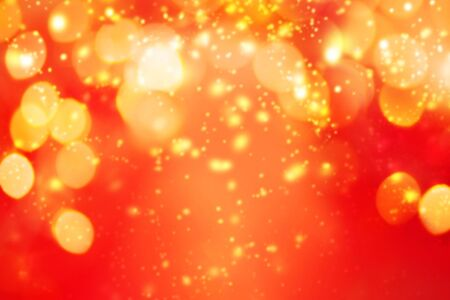 Christmas abstract red lights background. Festive xmas abstract background with bokeh defocused lights and stars. Card or invitation for your design
