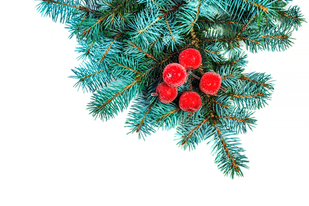Fir branch with Christmas Decorations isolated on white background close up. Frame made of green spruce branches for your design