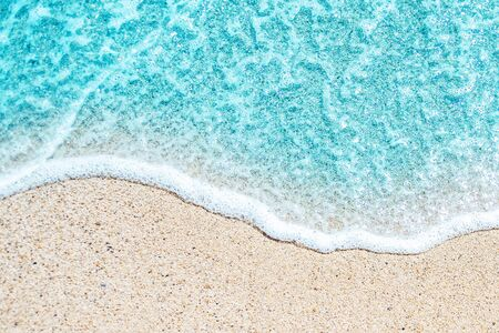 Sea Beach and Soft wave of blue ocean. Summer day and sandy beach background