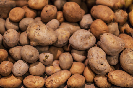 Raw potatoes,  food background. Fresh potatoes Raw Organic Golden Potatoes in grocery store Stock Photo
