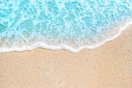 Summer background with Soft wave of blue ocean on sandy beach Stock Photo