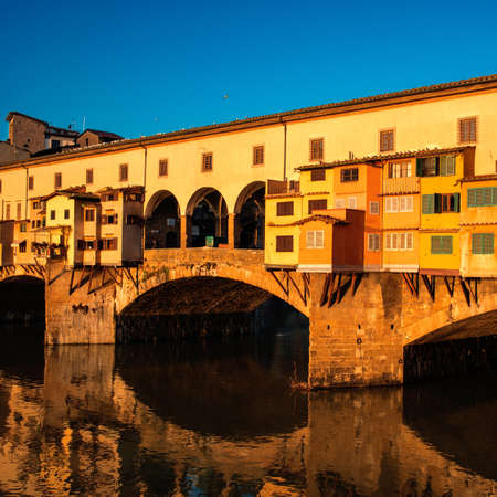 Florence, Italy - Ponte Vecchio over Arno River at sunset. Florence is a popular tourist destination of Europe.