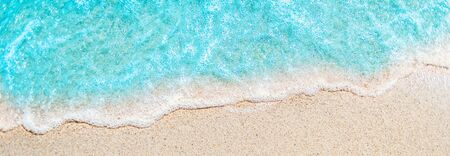 Soft wave of blue ocean on sandy beach with copy space fr text. Summer Background. Stock Photo