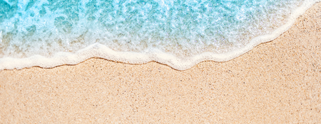 Soft wave of blue ocean on sandy beach with copy space fr text. Summer Background.