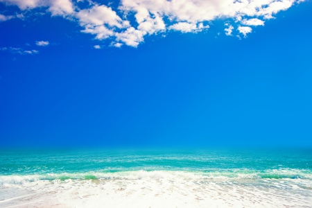 Beautiful beach with Soft waves of blue ocean on sandy beach. Tropical paradise.  Travel tourism background concept