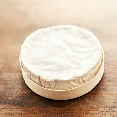 Cheese camembert on wooden desk, top view. Soft creamy cheese Brie with copy space 写真素材 - 110032401