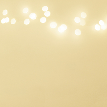 Abstract Golden Christmas Winter Background with festive glowing bokeh lights, copyspace 免版税图像