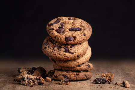 Chocolate chip cookies on dark background.