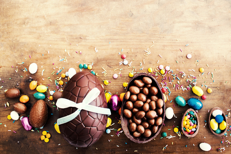 Easter Background with Chocolate eggs and copyspace. Top view.  Happy Easter! Stock Photo