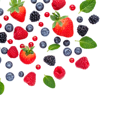 Falling Berries isolated on white background, top view. Strawberry, Raspberry, Cranberry, Blackberry, Blueberry and Mint leaf, flat lay