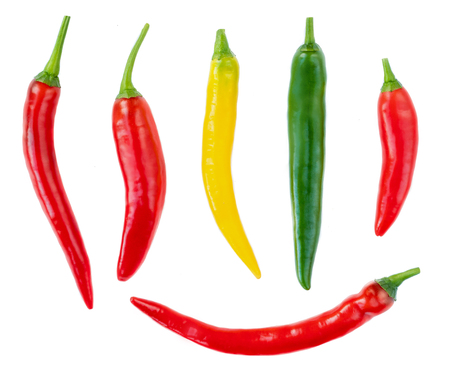 Collection of Chili peppers isolated on a white background. Top view. Food ingredient. Red, Yellow, Green pepper